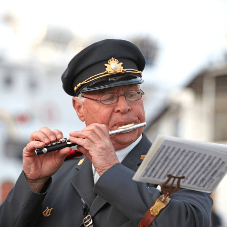 man in uniform playing the piccolo