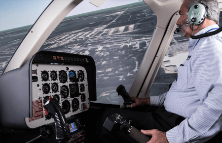 student pilot in a helicopter simulator