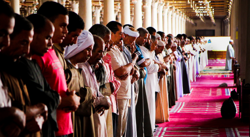 Muslims performing a ritual in a mosque